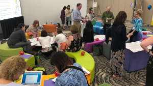 Image shows 2018 Summit participants in the Interactive Learning Village.