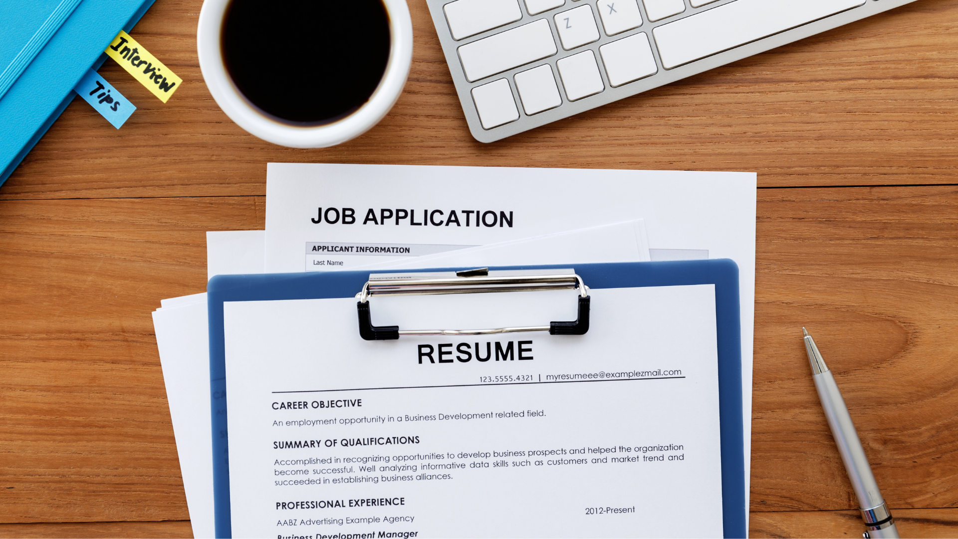 Image shows a job application on a desk.