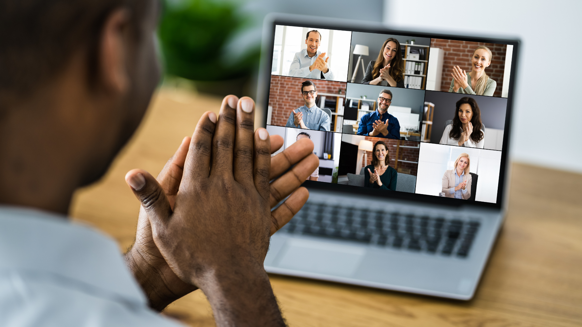 Image shows virtual meeting attendees applauding.